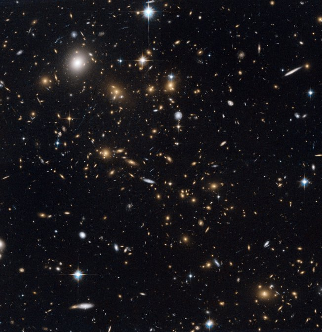 A Snowstorm of Distant Galaxies in the cluster MACS J0717.5+3745