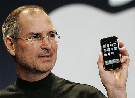 Steve Jobs with with one of his inspirational/inspired products, the iPhone